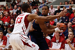 February 3, 2011; Stanford, CA, USA;  Arizona Wildcats forward Derrick Williams (back) is guarded by Stanford Cardinal forward/center Josh Owens (13) during the first half at Maples Pavilion.