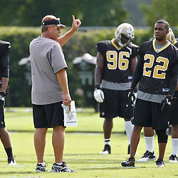 July 29, 2011; Metairie, LA, USA; New Orleans Saints defensive coordinator gives instructions to cornerback Tracy Porter (22) and Patrick Robinson (21)during the first day of training camp at the New Orleans Saints practice facility. Mandatory Credit: Derick E. Hingle