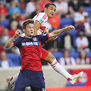Tim Cahill, New York Red Bulls, rises high over Greg Cochrane, Chicago Fire, to score with a header in the Red Bulls 5-4 loss during the New York Red Bulls Vs Chicago Fire, Major League Soccer regular season match at Red Bull Arena, Harrison, New Jersey. USA. 10th May 2014. Photo Tim Clayton