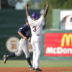 09 June 2008:  Jared Mitchell #3 for LSU raises his arms as a home run hit by Blake Dean sails over the fence to give LSU a 2-0 lead early in the first inning. The LSU Tigers advanced to the College World Series with a 21-7 victory over the UC Irvine Anteaters in game three of the NCAA Baseball Baton Rouge Super Regional Alex Box Stadium in Baton Rouge, LA..