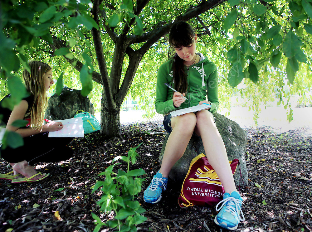 Students discuss and work on their writing outside the Fabiano Botanical Garden during the Chippewa River Writing Camp photo by Emily Mesner