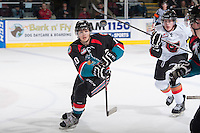 KELOWNA, CANADA - OCTOBER 22: Nick Merkley #10 of the Kelowna Rockets keeps his eye on the airborne puck on October 22, 2013 at Prospera Place in Kelowna, British Columbia, Canada.   (Photo by Marissa Baecker/Shoot the Breeze)  ***  Local Caption  ***