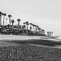 San Clemente CA beach black and white panorama photo. San Clemente is a popular coastal beach city along the Pacific Ocean in Orange County Southern California. Panoramic photo ratio is 1:3. Copyright ⓒ 2017 Paul Velgos with All Rights Reserved.