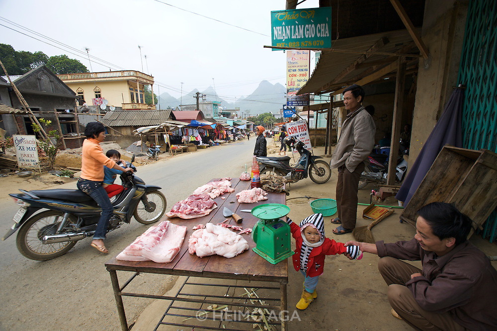 Hoang Lien Mountains. Butcher and child.