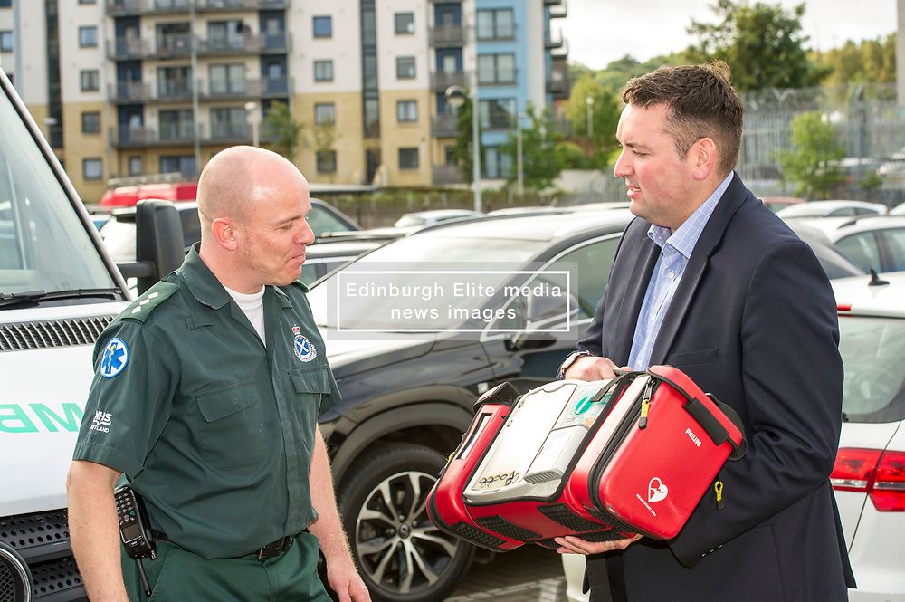 Pictured: Richard Patonand Mike Briggs.<br /> <br /> Scottish Conservative leader Ruth Davidson, MSP,  joined shadow health secretary Miles Briggs to launch the party's Health Advisory Board at the Scottish ASmbulance Service Southeast Divisional HQ.  Ms Davidson and Mr Briggs were shown the equipment in the average ambulance by Richard Paton, Ambulance Service manager and Callum Johnston, Specialist medic.<br /> <br /> Ger Harley | EEm 6 September 2017