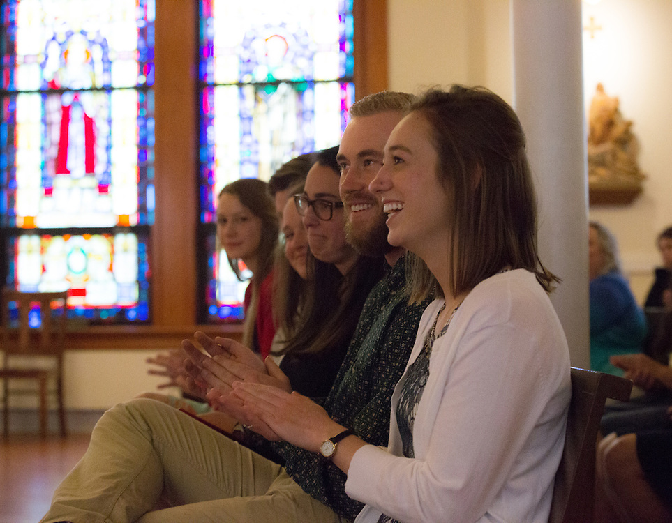 Graduates smile at the conclusion of the 2017 social justice missioning ceremony on May 12. The event took place in the Student Chapel in College Hall, led by keynote speaker Tyler Hobbs, and included the official pinning for senior social justice students.<br /> Photo by Libby Kamrowski