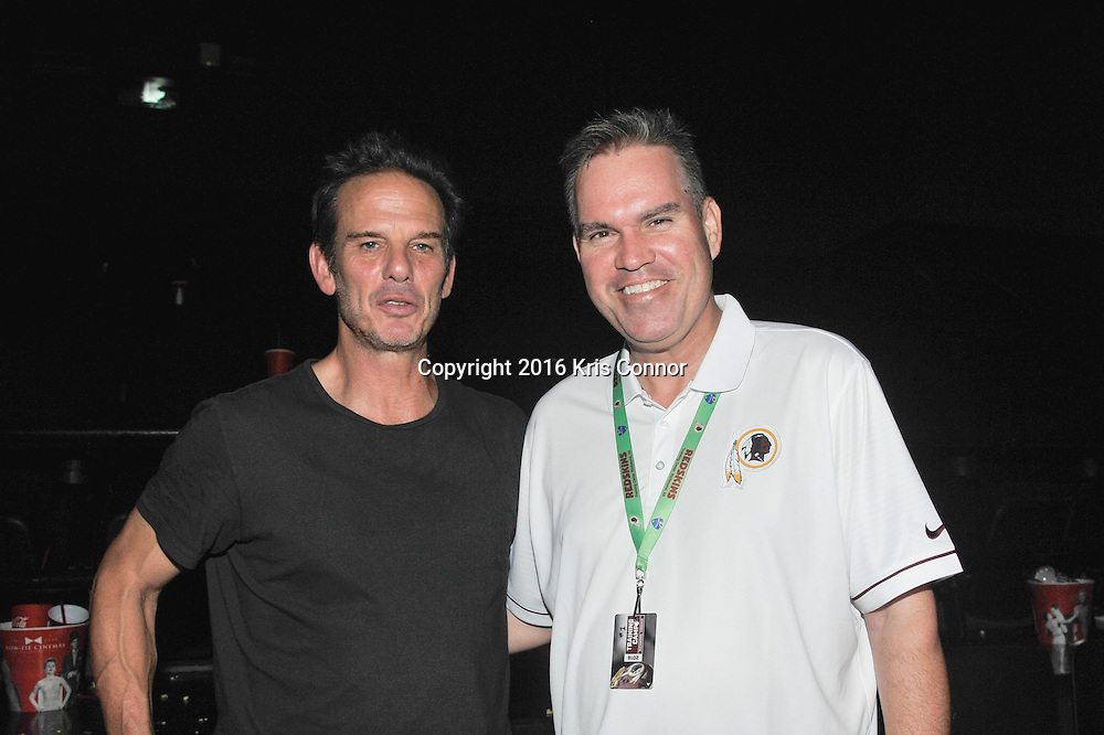 RICHMOND, VA - AUG 13: Director Peter Berg and Redskins Paul Kelly pose for a photo during a special screening for the Washington Redskins football team of Lions gate Entertainment's new movie Deepwater Horizon at Bow Tie Cinema on August 13, 2016 in Richmond, Va. (Photo by Kris Connor for Lions Gate Entertainment)