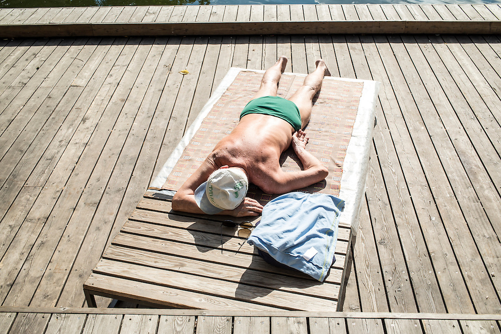 A man sunbathes in Gorky Park on Saturday, August 17, 2013 in Moscow, Russia.