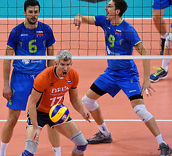 Mitja Gasparini #6/, Dejan Vincic #9, Rob Bontje #17 during volleyball match between National teams of Netherlands and Slovenia in Playoff of 2015 CEV Volleyball European Championship - Men, on October 13, 2015 in Arena Armeec, Sofia, Bulgaria. Photo by Ronald Hoogendoorn / Sportida
