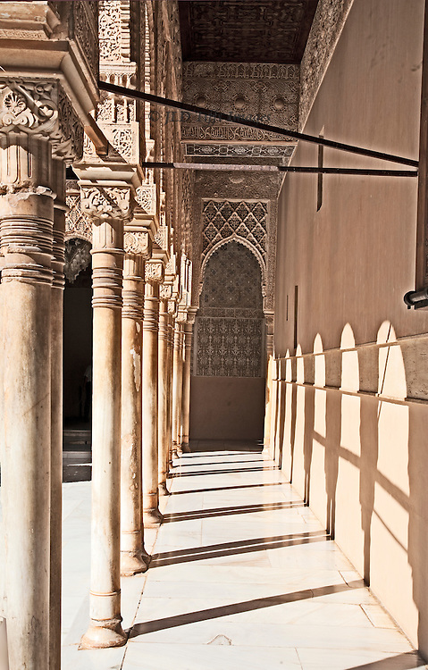 View along a colonnade of the Patio de los Leones, in the Alhambra.