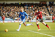 Shrewsbury Town FC defender Joe Riley (2) loses the ball to Gillingham FC midfielder Scott Wagstaff (7) during the EFL Sky Bet League 1 match between Gillingham and Shrewsbury Town at the MEMS Priestfield Stadium, Gillingham, England on 28 January 2017. Photo by Andy Walter.
