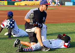 July 5, 2017 - Trenton, New Jersey, U.S - Trenton Thunder Strength Coach ANTHONY VELAZQUEZ helps Thunder player JORGEO MATEO stretch before the game tonight vs. the Fightin Phils at ARM & HAMMER Park. The team wore patriotic jerseys for the games on July 4th and today, July 5th. (Credit Image: © Staton Rabin via ZUMA Wire)