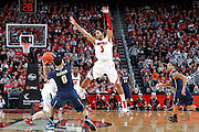 LOUISVILLE, KY - JANUARY 28: Peyton Siva #3 of the Louisville Cardinals defends against James Robinson #0 of the Pittsburgh Panthers during the game at KFC Yum! Center on January 28, 2013 in Louisville, Kentucky. Louisville defeated Pitt 64-61. (Photo by Joe Robbins)