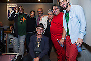 Havana, Cuba,December 18, 2014: Jazz master drummer and singer, Bobby Kapp, seated, with l-r: Alfredo Thompson (tenor sax), Adel Gonzales (congas/percussion), Frank Rubio (bass), Cesar Lopez (alto sax), Gabriel Hernandez (musical director/arranger), Ruly Herrero (drums) record at the Abdala Estudio in Havana. Gabriel Hernanez (red track suit) is the composer and musical director.  12/16/2014 (Photo: Ann Summa).