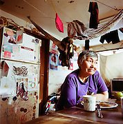 "Ardith Weyiouanna.Ardith Weyiouanna in her home in Shishmaref, Alaska in March 2010.Ardith Weyiouanna, wife to original cookbook contributor Johnnie Weyiouanna, invited us into her home to enjoy a meal of sourdough hotcakes and salted herring.  ""They're called hotcakes, not pancakes,"" she said. ""Pancakes are what come from a box!"" Ardith prepares hotcakes everyday from the same recipe her mother used. ""I know that they probably came from the White Man,"" she said, serving us our stacks. ""But they've been in my family for generations now."" Her husband laughed, ""Many times those hotcakes were what got us through the long days."""