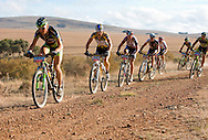 GREYTON, SOUTH AFRICA - Hannes Genze leads the front bunch during stage five , 5 , of the Absa Cape Epic Mountain Bike Stage Race held between Greyton and Oak Valley ( Elgin / Grabouw ) on the 26 March 2009 in the Western Cape, South Africa..Photo by Nick Muzik  /SPORTZPICS