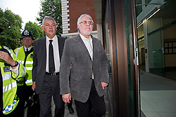 © London News Pictures. 03/10/2013 . London, UK.   Radio DJ DAVE LEE TRAVIS (pictured centre, also known as David Patrick Griffin) arriving at Westminster Magistrates court in London where he is charged with two counts of indecent assault on a woman aged over 16 between 1992 and 1993. Travis has already appeared in court to face the original 12 charges, which include indecent assault and sexual assault. Photo credit : Ben Cawthra/LNP