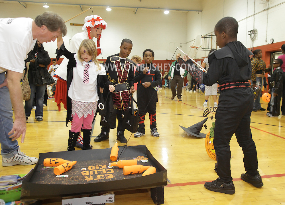 Middletown, New York - Children wearing costumes play a game as a volunteer helps during the Family Fall Festival at the Middletown YMCA on Oct. 23, 2010.