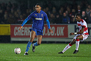 AFC Wimbledon defender Terell Thomas (6) passing the ball during the The FA Cup match between AFC Wimbledon and Doncaster Rovers at the Cherry Red Records Stadium, Kingston, England on 9 November 2019.