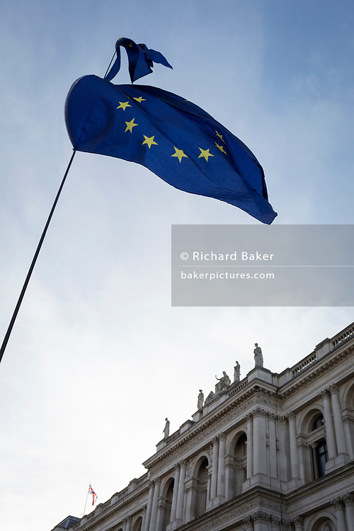 On the day that Prime Minister Theresa May petitions her cabinet on the current negotiations to leave the EU, pro-Europe  protesters's flags fly in front of government buildings opposite Downing Street in Whitehall, on 14th November 2018, in London, England.