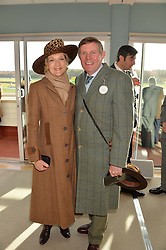 BARONESS SHACKLETON OF BELGRAVIA and her husband IAN SHACKLETON at the 2013 Hennessy Gold Cup at Newbury Racecourse, Berkshire on 30th November 2013.