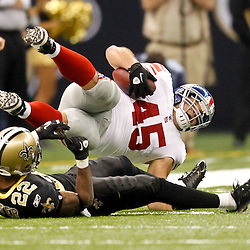 November 28, 2011; New Orleans, LA, USA; New Orleans Saints cornerback Tracy Porter (22) upends New York Giants fullback Henry Hynoski (45) during the second quarter of a game at the Mercedes-Benz Superdome. Mandatory Credit: Derick E. Hingle-US PRESSWIRE