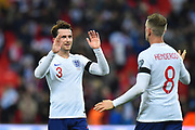 Ben Chilwell of England celebrates with Jordan Henderson of England at full time after England won 5-0 during the UEFA European 2020 Qualifier match between England and Czech Republic at Wembley Stadium, London, England on 22 March 2019.