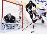 The Blackhawks' Jonathan Toews tries to score on Kings' goaltender Jonathan Quick as Anze Kopitar helps defend during the second period of Game 6 of the Western Conference Final of the 2014 NHL Stanley Cup Playoffs at Staples Center Friday night.