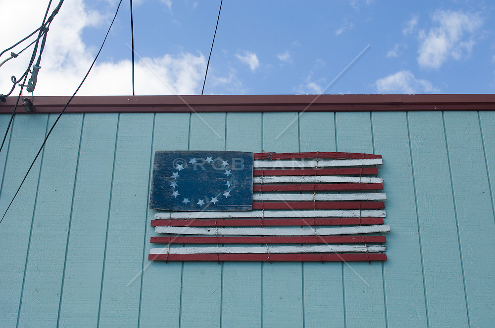 painted wooden piece arranged to create a thirteen star flag
