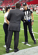 In a historic moment, Arizona Cardinals team president Michael Bidwill talks to Arizona Cardinals coach Jen Welter, the first female coach in the NFL, and line judge Sarah Thomas, the first female official in the NFL, before the 2015 NFL preseason football game against the Kansas City Chiefs on Saturday, Aug. 15, 2015 in Glendale, Ariz. Welter's credentials include a phD and an MS in Sports Psychology. The Chiefs won the game 34-19. (©Paul Anthony Spinelli)