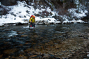 Nathan Sackett crossing the Strawberry River after climbing Dead Deer Falls WI4, Strawberry Pinnacles, Utah