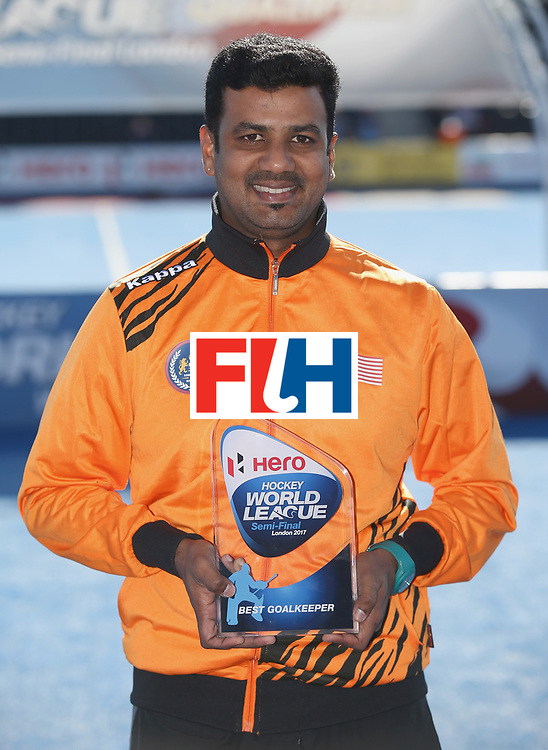 LONDON, ENGLAND - JUNE 25: Kumar Subramiam of Malaysia poses with his Best Goalkeeper award after the final match between Argentina and the Netherlands on day nine of the Hero Hockey World League Semi-Final at Lee Valley Hockey and Tennis Centre on June 25, 2017 in London, England. (Photo by Steve Bardens/Getty Images)