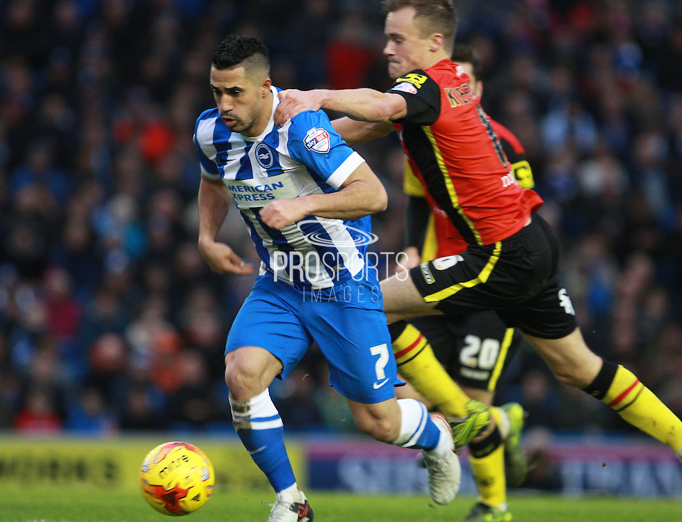 Brighton central midfielder Beram Kayal is dragged back by Birmingham City midfielder Maikel Kieftenbeld during the Sky Bet Championship match between Brighton and Hove Albion and Birmingham City at the American Express Community Stadium, Brighton and Hove, England on 28 November 2015. Photo by Bennett Dean.