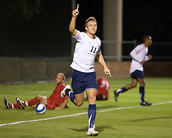 Virginia Cavaliers F Yannick Reyering (11) reacts after scoring his second goal of the game.  The Virginia Cavaliers men's soccer team faced the Liberty Flames  in at Klockner Stadium in Charlottesville, VA on October 23, 2007.
