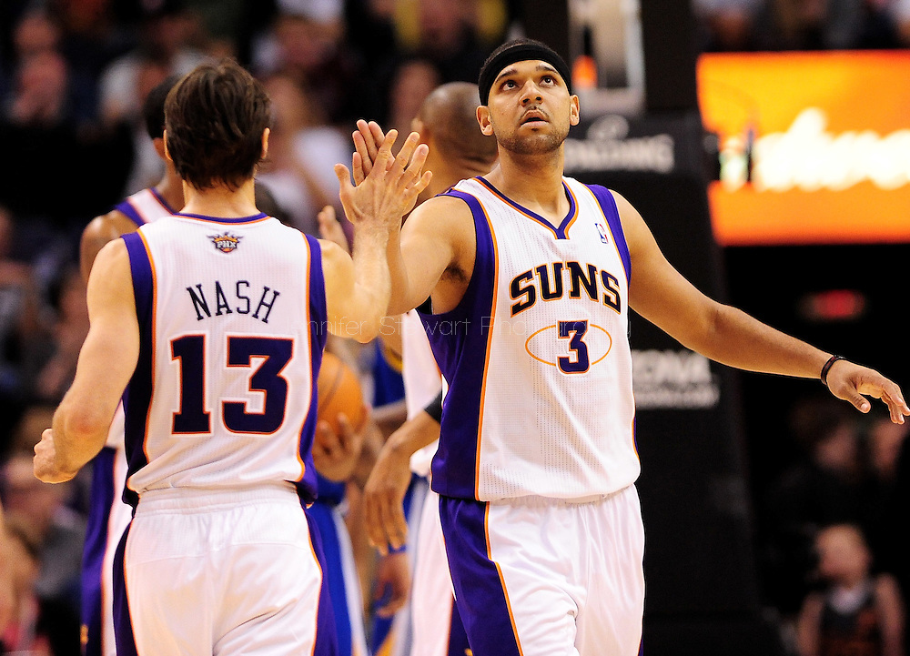 Feb. 22, 2012; Phoenix, AZ, USA; Phoenix Suns forward Jared Dudley (3) and guard Steve Nash (13) react on the court against the Golden State Warriors at the US Airways Center. The Warriors defeated the Suns 106 - 104. Mandatory Credit: Jennifer Stewart-US PRESSWIRE.
