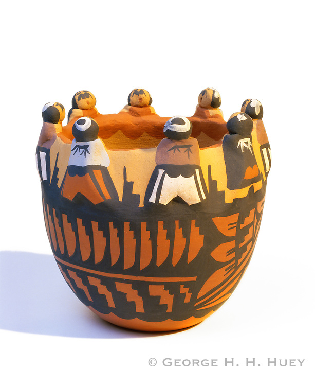 0194-1007 ~ Copyright:  George H. H. Huey ~ Pueblo Indian 'friendship bowl', depicting children gathered around a rainwater cistern.  Made by Caroline Sando of Jemez Pueblo. Painted ceramic.  Native American folk art.  New Mexico.
