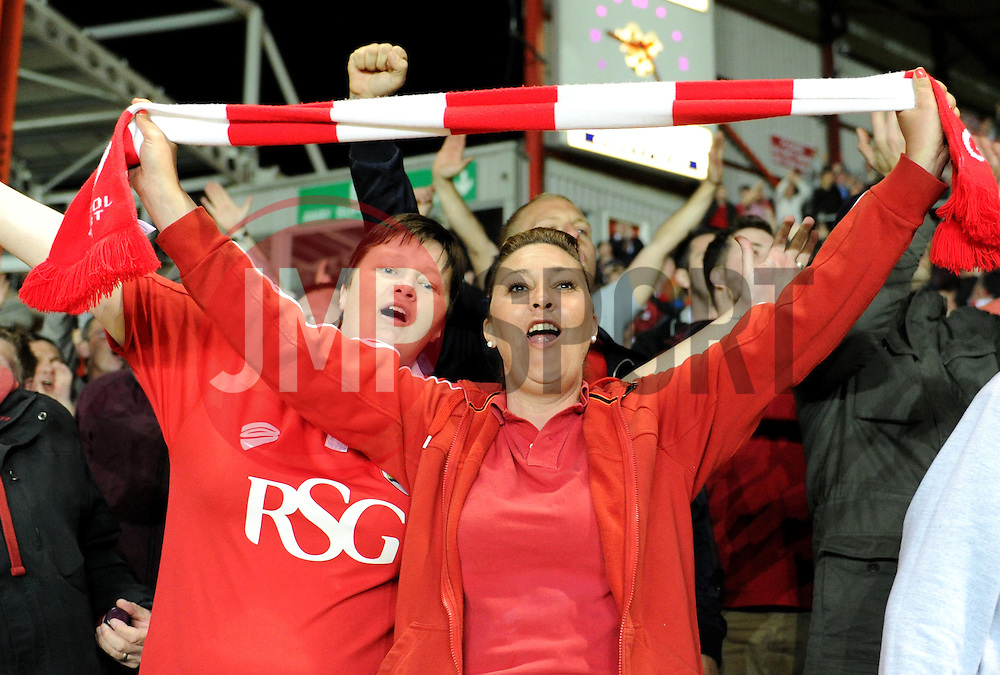 Bristol City supporters celebrate Joe Bryan's goal - Photo mandatory by-line: Paul Knight/JMP - Mobile: 07966 386802 - 07/04/2015 - SPORT - Football - Bristol - Ashton Gate Stadium - Bristol City v Swindon Town - Sky Bet League One