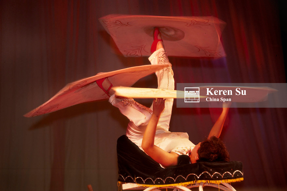 Acrobatic performance, twirling four pieces of cloth at the same time, Shanghai, China