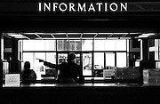 silhouette of people at the Information Desk at the Los Angeles Union train station