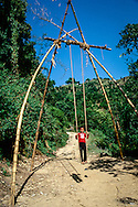 A child plays on a bamboo swing in the outskirts of pokhara