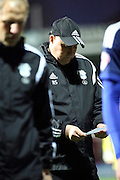 Cardiff City manager, Russell Slade checking his notes during the Sky Bet Championship match between Brentford and Cardiff City at Griffin Park, London, England on 19 April 2016. Photo by Matthew Redman.