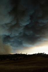 September 12, 2015 - Lake County, California. Valley Fire appraochs Hidden Valley, smoke clouds obscure the sun.  (Kim Ringeisen / Polaris)