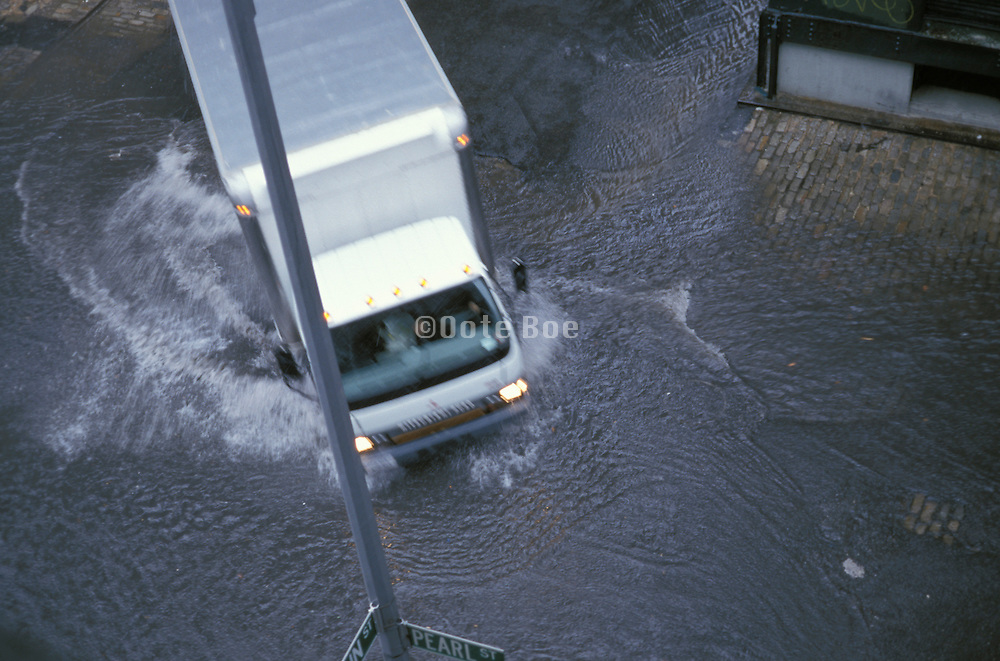 overhead view of truck hydroplaning through a large puddle