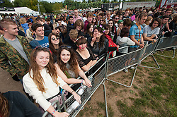 © Licensed to London News Pictures. 22/08/2014. Reading, UK.   Festival goers at Reading Festival 2014 on Friday morning, the opening day.  Here they wait at the barrier for the gates to the main festival arena open.   The weather is sunny with light cloud.   Today is expected to remain dry with a 25% risk of showers.  Photo credit : Richard Isaac/LNP