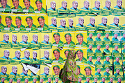 Dar es Salaam, Tanzania - 20.10.15  - A woman walks past posters for ruling party Chama Cha Mapinduzi (CCM) presidential candidate John Magufuli and parliamentary candidate Hassan Zungu in Dar es Salaam, Tanzania on October 20, 2015.  Photo by Daniel Hayduk