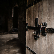 A solid oak door leads into a room at Caernarfon Castle in northwest Wales. A castle originally stood on the site dating back to the late 11th century, but in the late 13th century King Edward I commissioned a new structure that stands to this day. It has distinctive towers and is one of the best preserved of the series of castles Edward I commissioned.