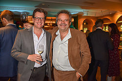 Left to right, William Sitwell and Mark Hix at the launch of the Fortnum & Mason Christmas & Other Winter Feasts Cook Book by Tom Parker Bowles held at Fortnum & Mason, 181 Piccadilly, London, England. 17 October 2018.