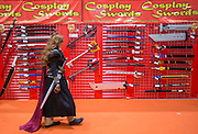 UNITED KINGDOM, London: 23 October 2015 A cosplay fan walks past Cos-Safe Weapons at the 2015 MCM London Comic Con which is being held at London's ExCel Arena. The event will be host to more than 110,000 comic con fans and cosplay enthusiasts over the weekend. Rick Findler / Story Picture Agency
