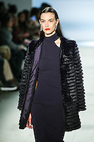 Ronja Furrer walks the runway wearing Cushnie et Ochs Fall 2016, hair by Antonio Corral Calero for Moroccanoil, makeup by Val Garland, photographed by Thomas Concordia during New York Fashion Week on February 12, 2016