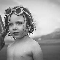 Female child close up with sunglasses on beach